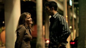stock-footage-man-and-woman-talking-outside-at-night