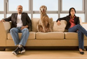 getty_rf_photo_of_dog_sitting_between_couple